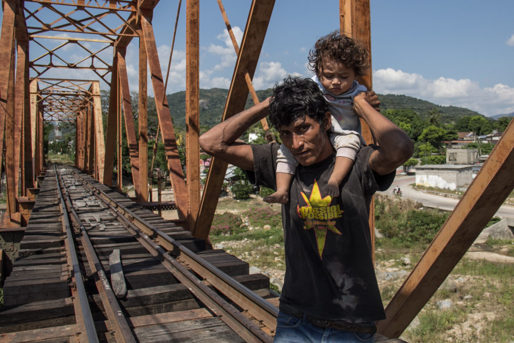 A father and his 2 years old daughter waits in the tracks for the beast to come.