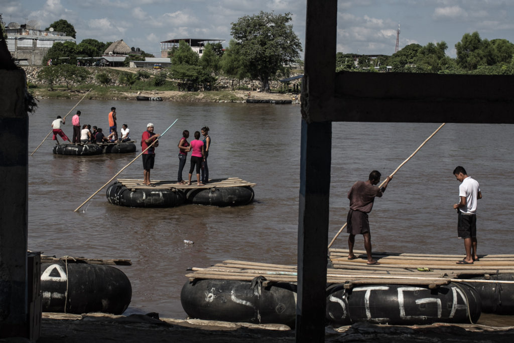 Rafts are used to cross immigrants from Guatemala to Mexico in Suchiate River; A natural border between Mexico and Guatemala.
