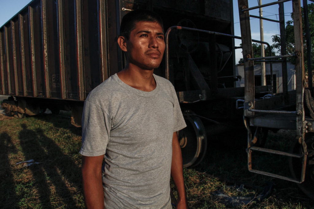 A immigrant waits the departure of the Beast in Arriaga, Chiapas.